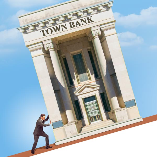 Man pushing a bank up a hill