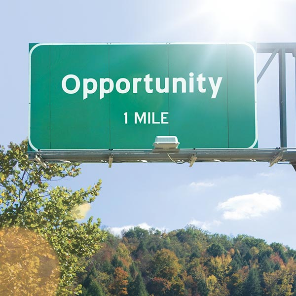 Road sign indicating opportunity lies ahead